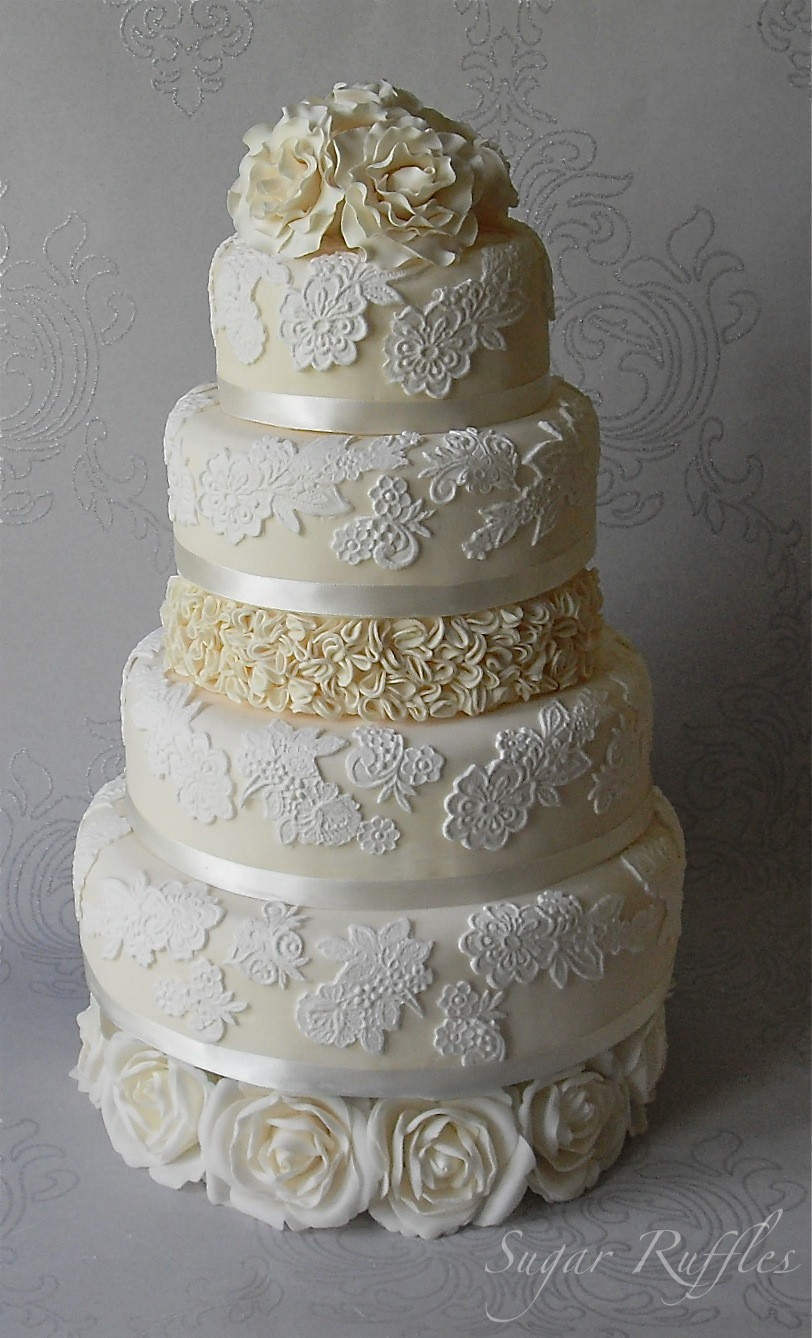 Lace Wedding Cakes  Lace wedding cake with ruffles and roses