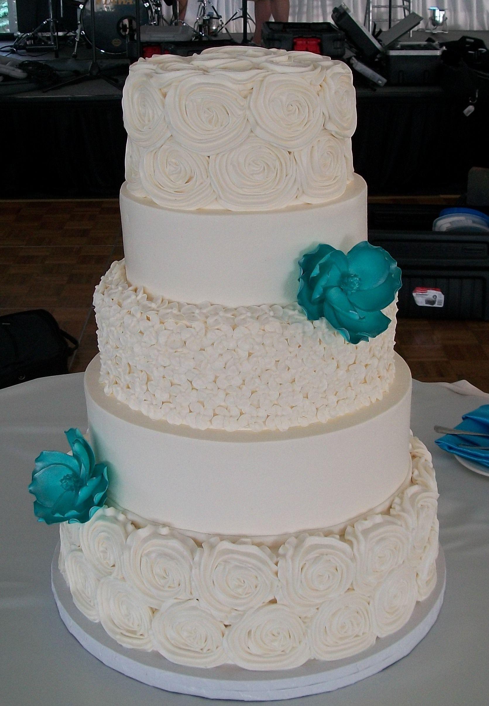Lovin Oven Wedding Cakes  Christina & Josh s white w turquoise flower wedding cake