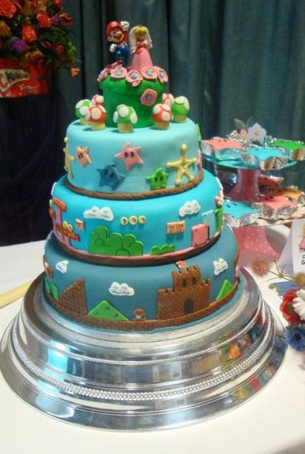 Mario Wedding Cakes  Three tier Super Mario theme wedding cake with Mario and