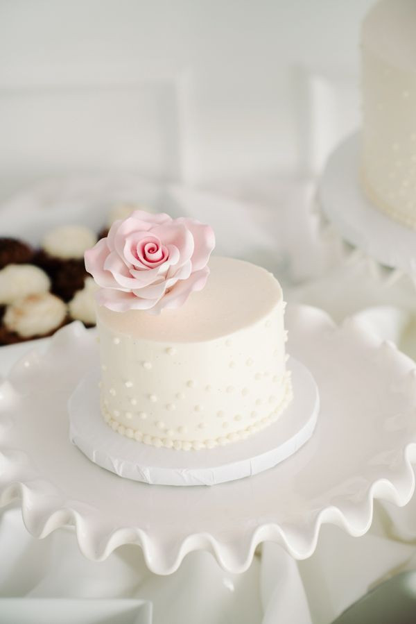 Mini Wedding Cakes  mini white wedding cake and pink sugar flower