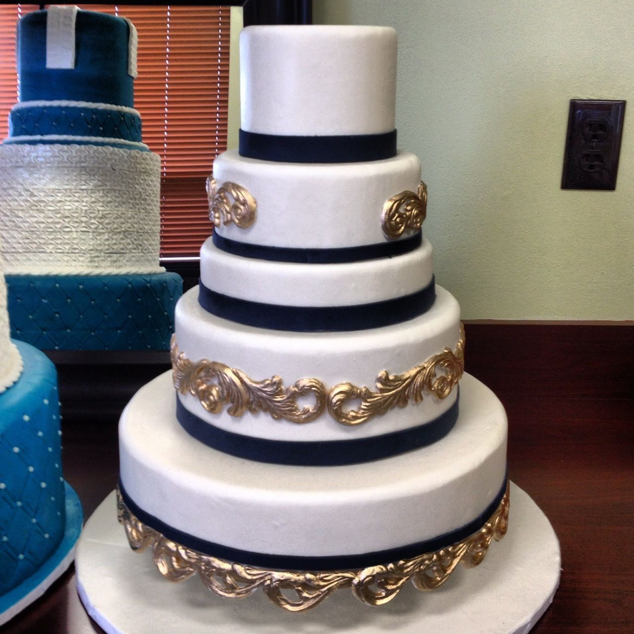 Navy Blue And Gold Wedding Cakes  I love the navy blue and gold on this cake fondarific