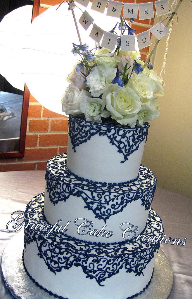 Navy Blue Wedding Cakes  Elegant Ivory Wedding Cake with Navy Blue Lace