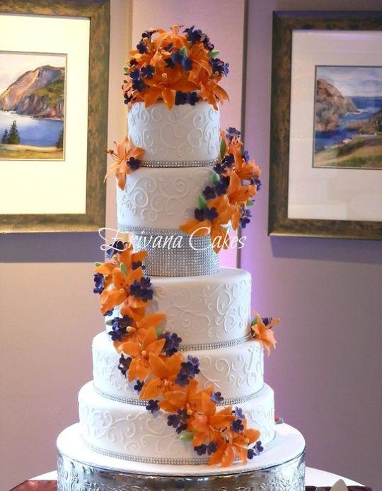 Orange And Purple Wedding Cakes  Wedding Cake with orange and purple gumpaste flowers