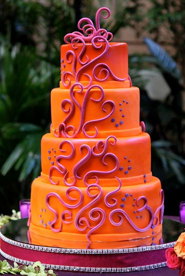 Orange And Purple Wedding Cakes  Four tier round orange wedding cake with purple wave decor JPG