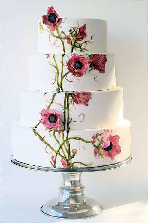 Painted Wedding Cakes  A four tiered wedding cake features hand painted flowers