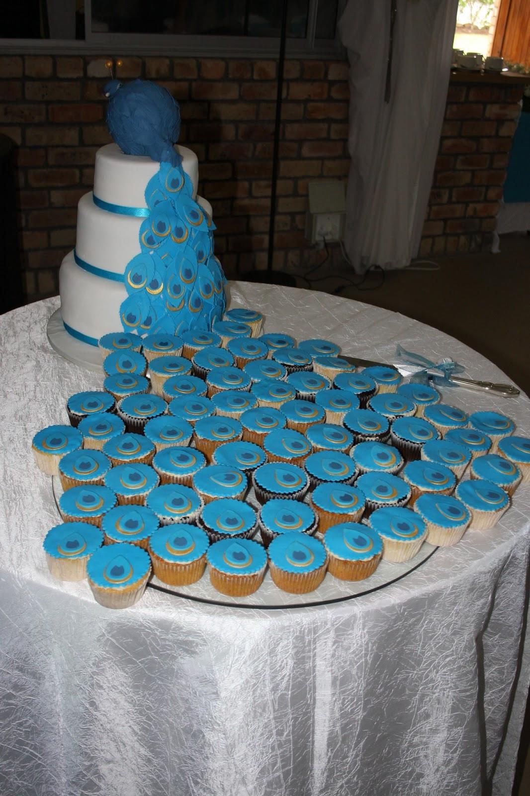 Peacock Wedding Cake With Cupcakes  Koekerasie Peacock cake and cupcakes
