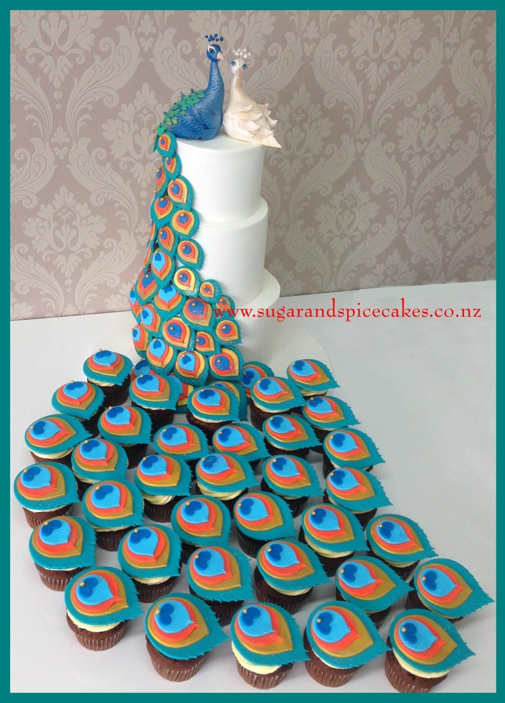 Peacock Wedding Cake With Cupcakes  Peacock Wedding Cake With Matching Cupcakes CakeCentral
