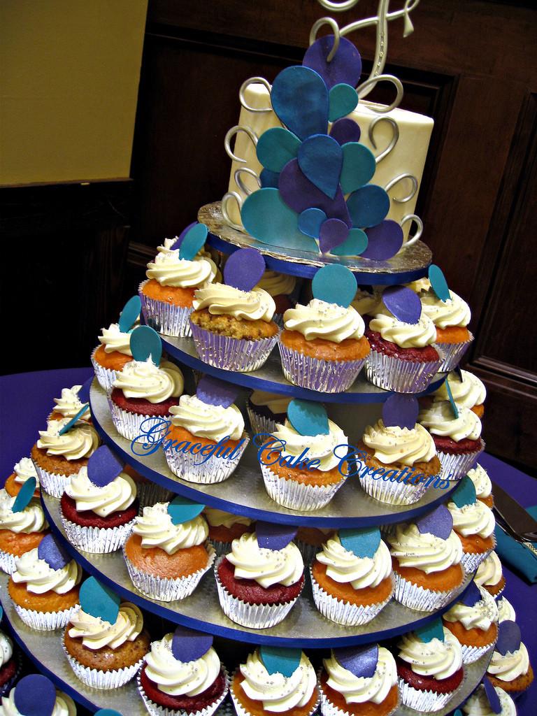 Peacock Wedding Cake With Cupcakes  Peacock Themed Cupcake Wedding Cake a photo on Flickriver