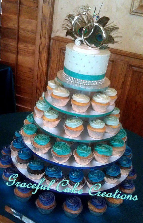 Peacock Wedding Cake With Cupcakes  Peacock Themed Cupcake Wedding Cake in an Ombre Design