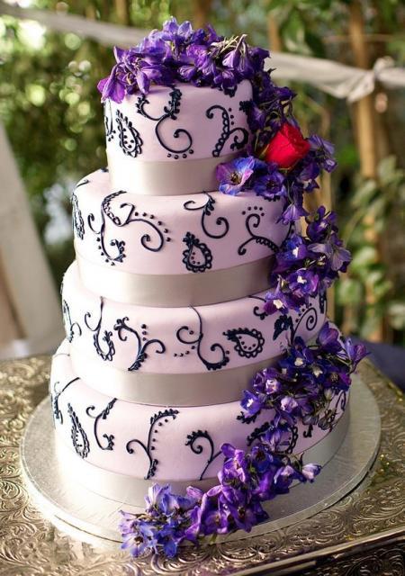 Pink And Purple Wedding Cakes  4 Tier Pink Wedding Cake Cascading Purple Flowers JPG