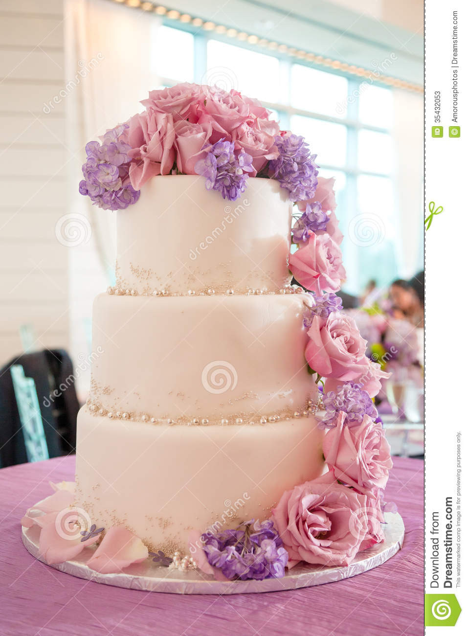 Pink And Purple Wedding Cakes  Wedding Cake With Pink And Purple Flowers Stock Image