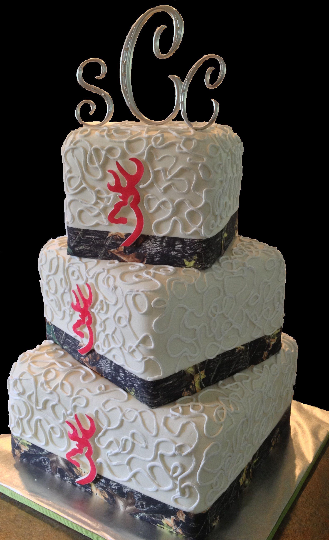 Pink Camouflage Wedding Cakes  Camo and pink Browning logo wedding cake