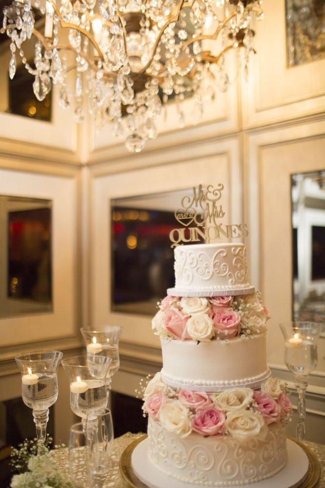 Portos Bakery Wedding Cakes  3 tier wedding cake with fresh flowers provided by porto s