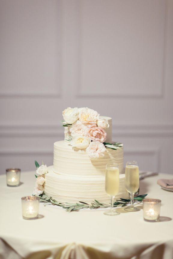 Portos Bakery Wedding Cakes  Ivory Wedding Cake With Pastel Colored Flowers