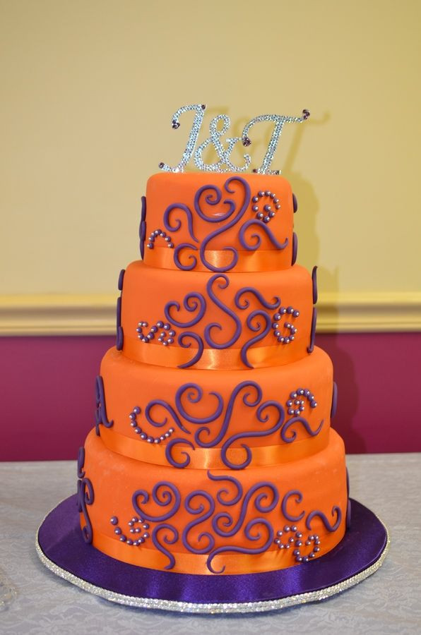 Purple And Orange Wedding Cakes  4 tier wedding cake Orange with purple and silver accents