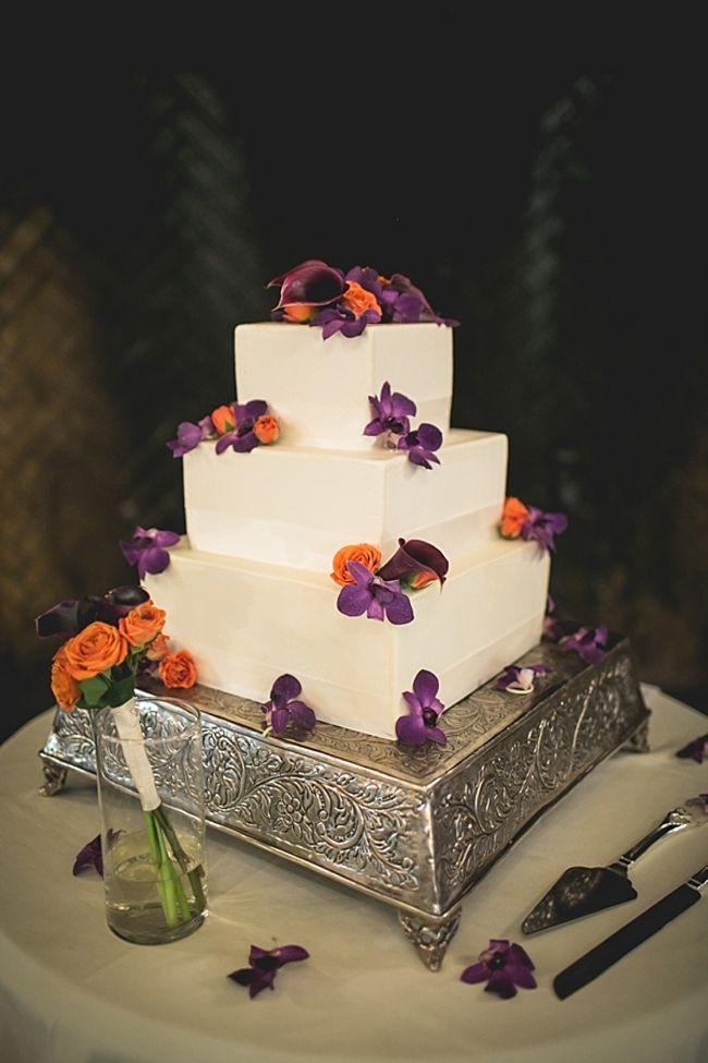 Purple And Orange Wedding Cakes  Wedding cake with orange and purple flowers
