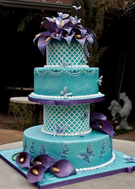 Purple And Teal Wedding Cakes  Four tier teal wedding cake with butterfly imprints and