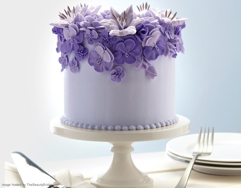 Purple And White Wedding Cake  Beautiful purple wedding cakes with floral details