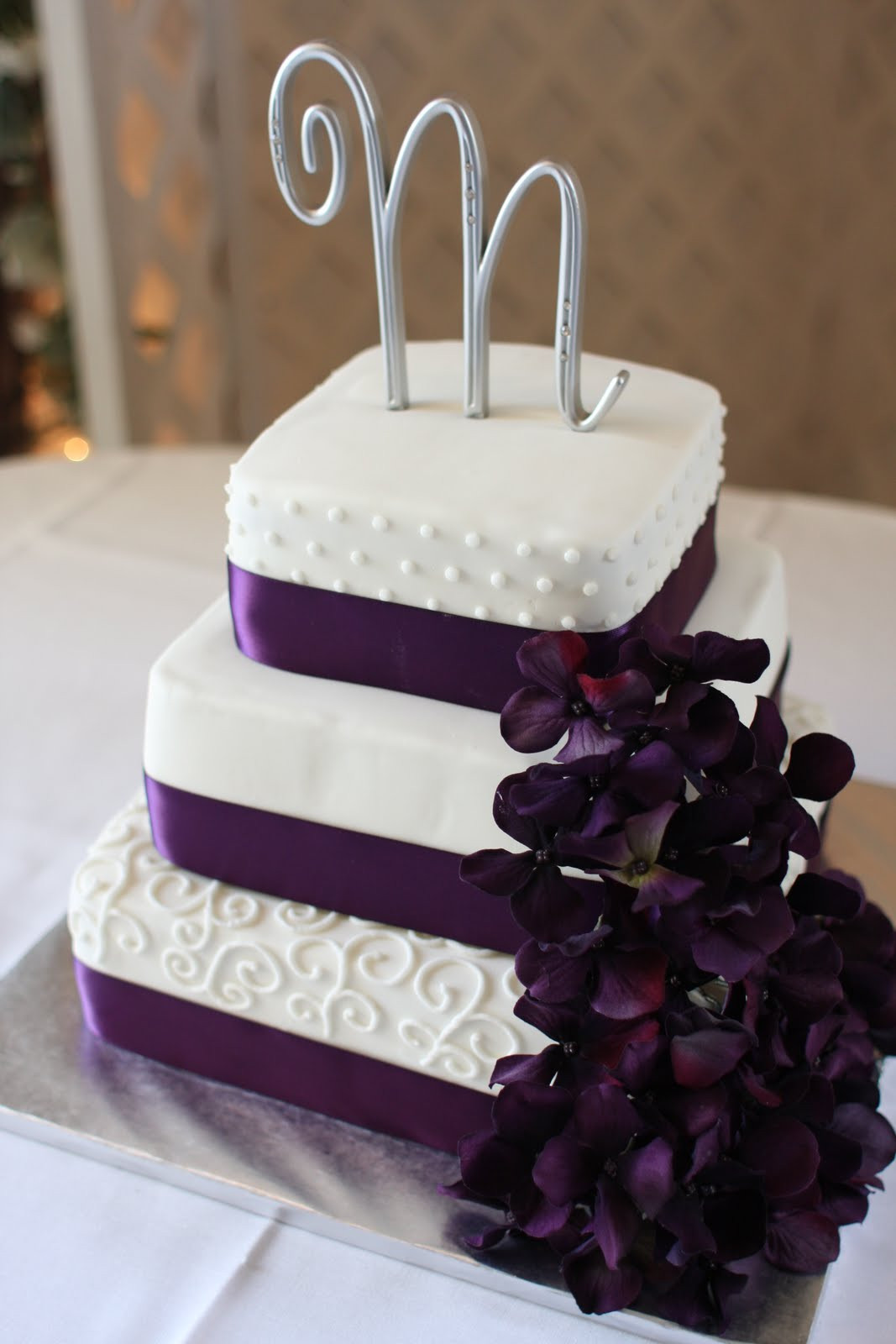 Purple And White Wedding Cakes  The Buttercream Bakery Purple & White Wedding Cake