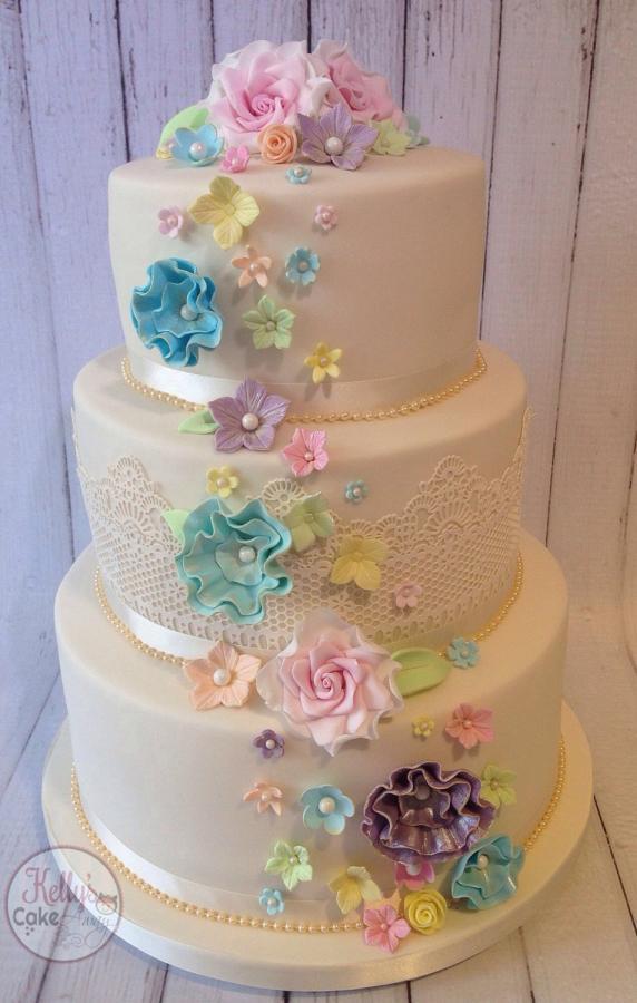 Rainbow Wedding Cakes  Pastel rainbow flower cascade wedding cake cake by Kelly