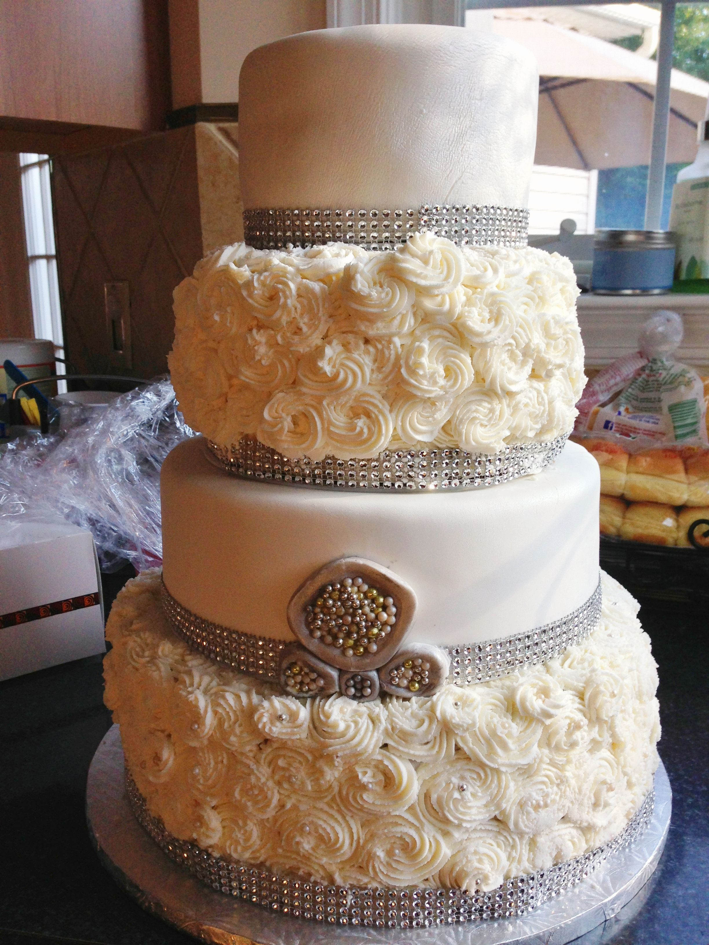 Rosette Wedding Cakes  Glam rhinestone and rosette wedding cake