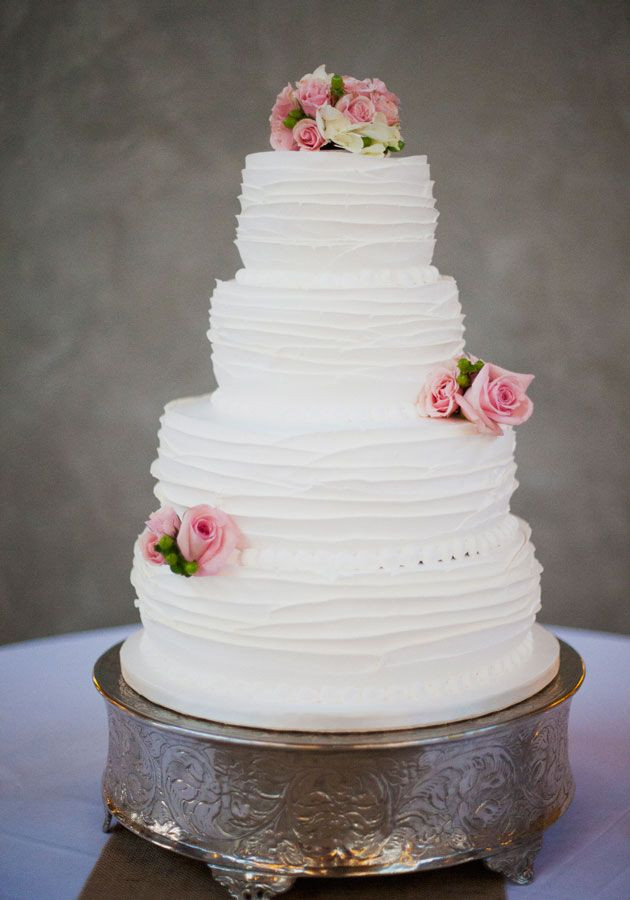 Ruffles Wedding Cakes  4 tier ruffle cake in white
