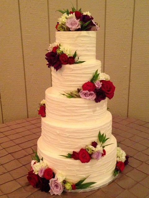 Rustic Buttercream Wedding Cakes  Rustic rough textured buttercream wedding cake with fresh