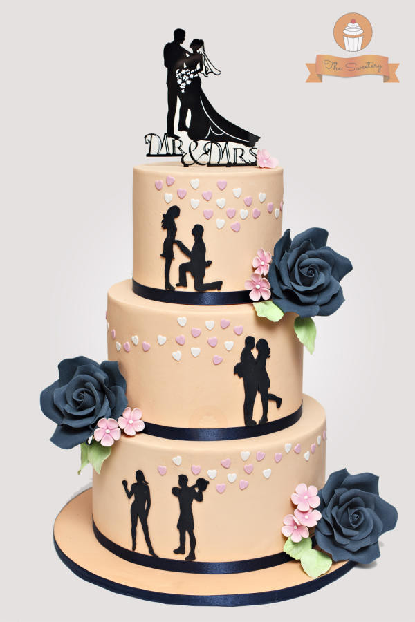 Silhouette Wedding Cakes  Silhouette Wedding cake in peach and navy blue Cake by