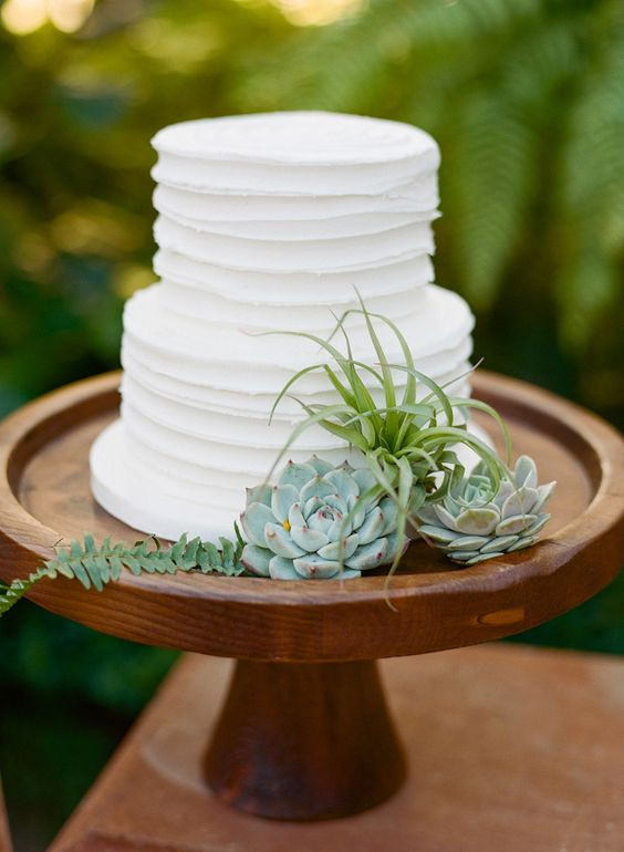 Simple 2 Tiered Wedding Cakes  Simple two tier white wedding cake on a wooden stand