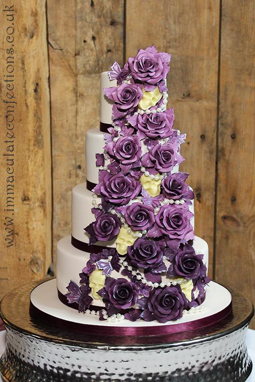 Skull Wedding Cakes  Plum Roses and Chocolate Skulls Wedding Cake Cakes by