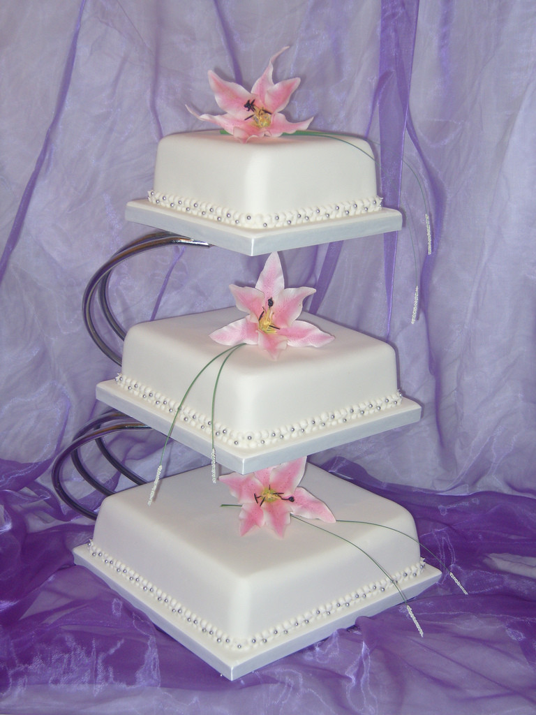 Square Cake Stand For Wedding Cakes  3 tier square wedding cake with lillies on stand