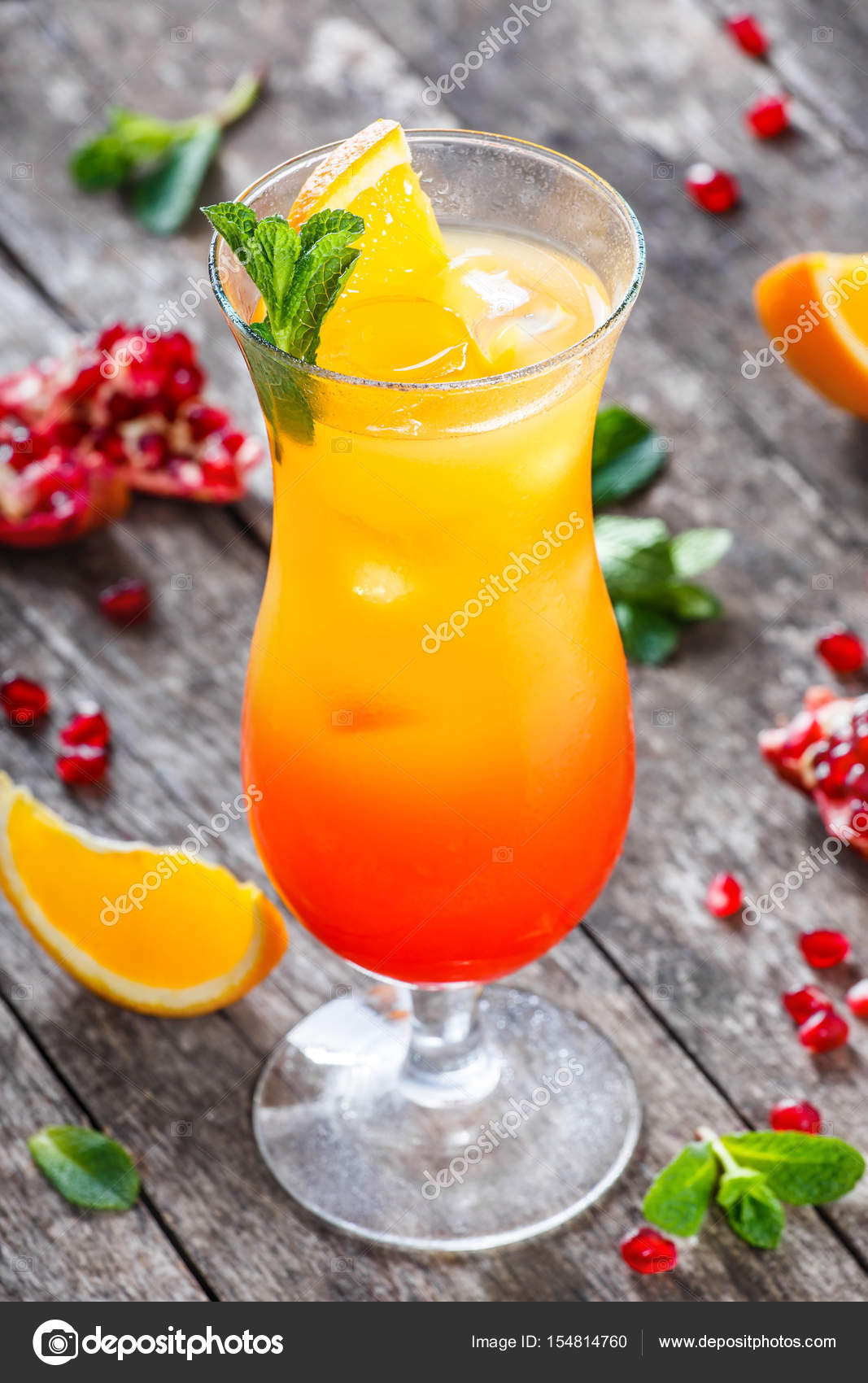 Summer Drinks With Tequila  Tequila sunrise cocktail with mint orange and pomegranate