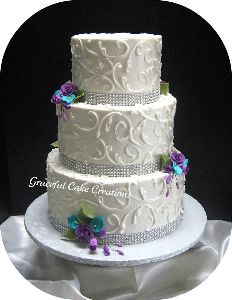 Teal And Purple Wedding Cakes  Elegant White Wedding Cake with Crystal Ribbon accented