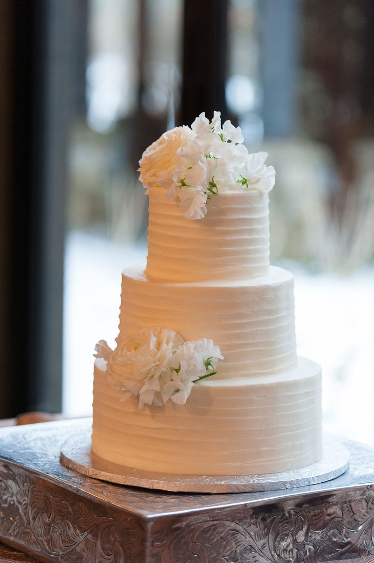 Textured Buttercream Wedding Cakes  White Lisianthus Topped Textured White Buttercream Wedding