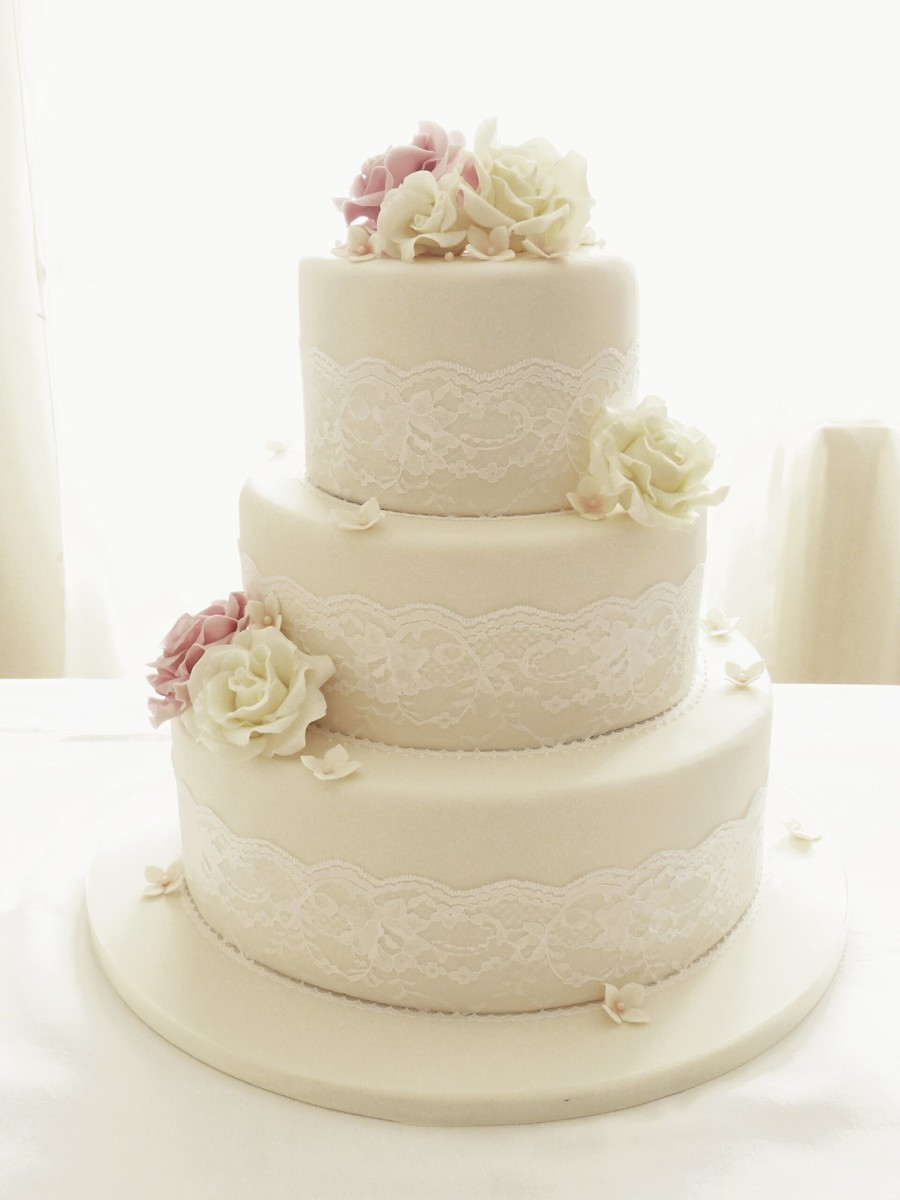 Three Tear Wedding Cakes  Ivory Roses And Lace Three Tier Wedding Cake CakeCentral