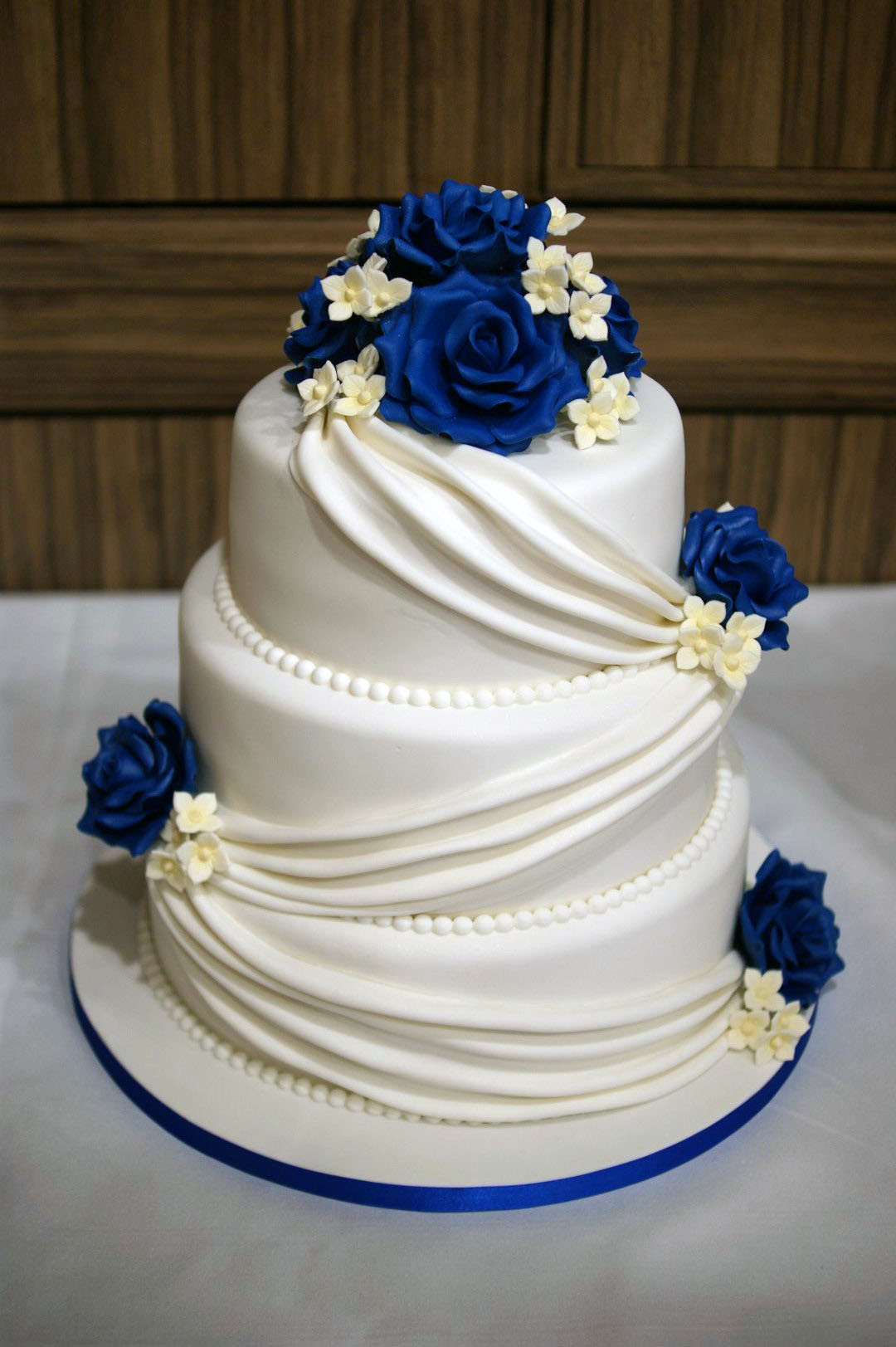 Three Tear Wedding Cakes  3 tier wedding cake drapes and roses with cupcake tower 10