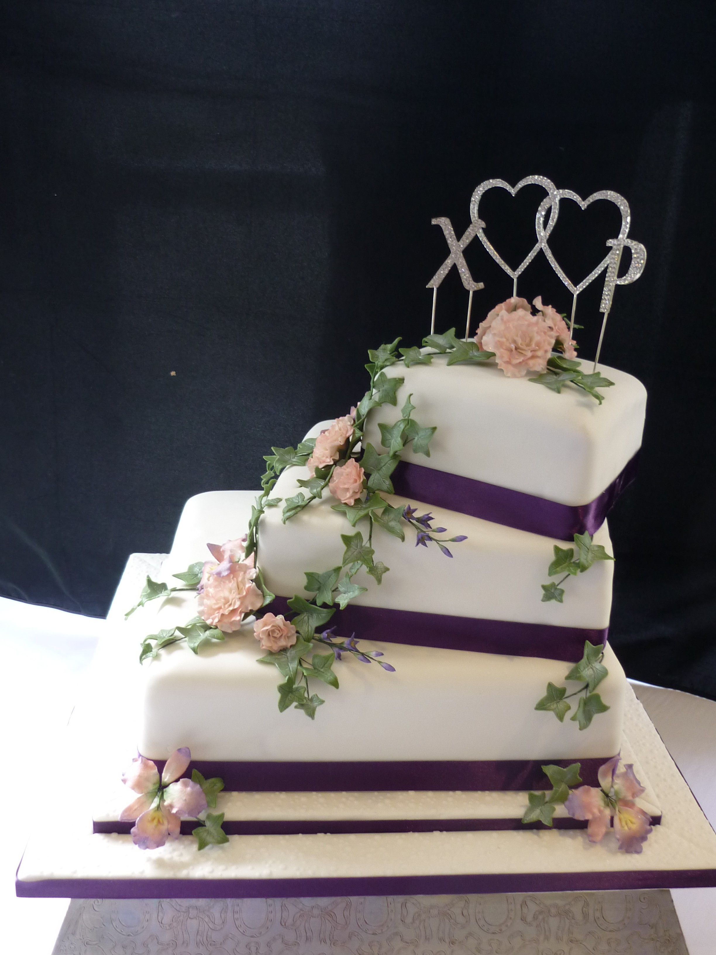 Three Tear Wedding Cakes  3 tier square orchid and rose wedding cake