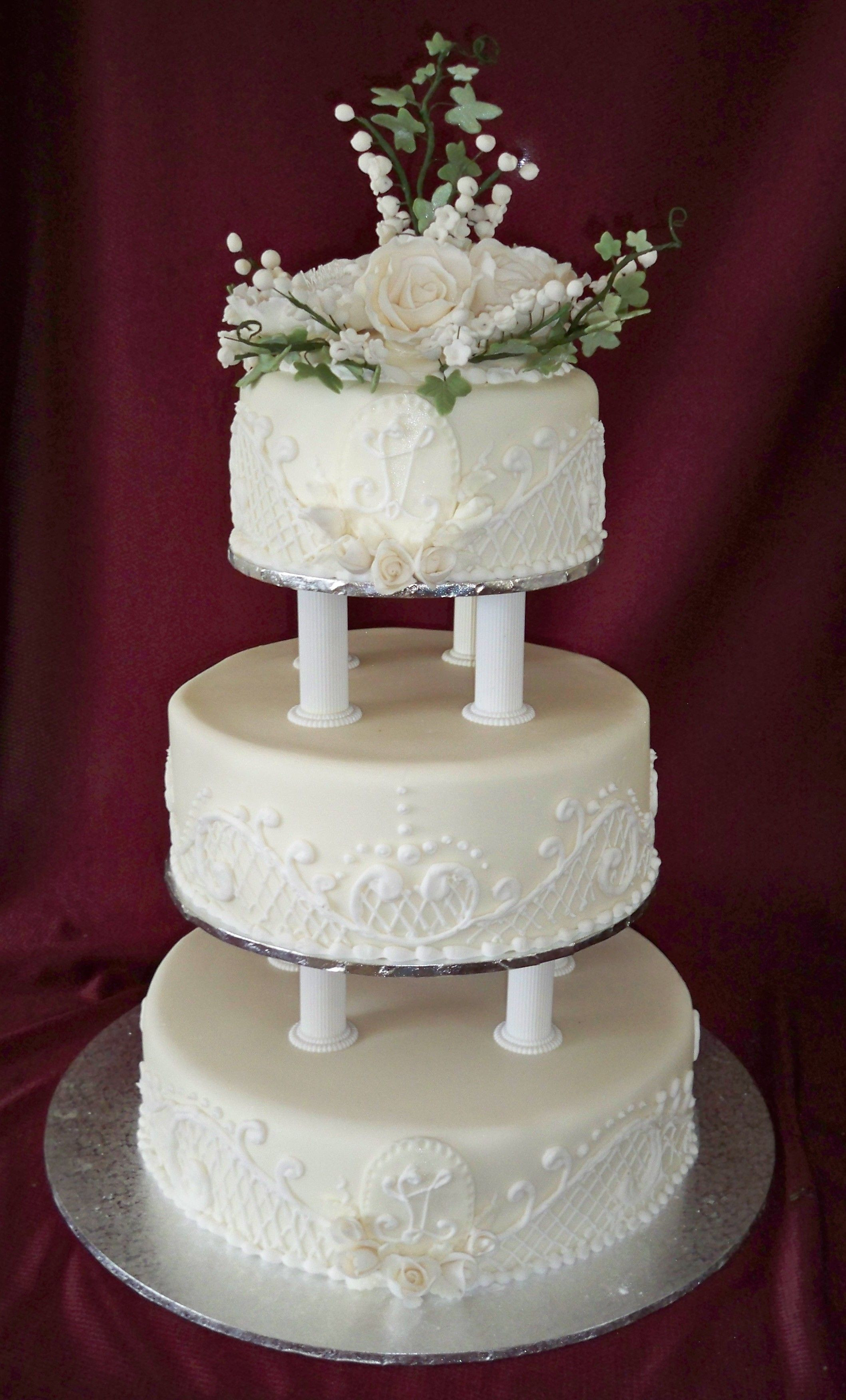 Tiered Wedding Cakes  3 tier round traditional wedding cake with lace piping and