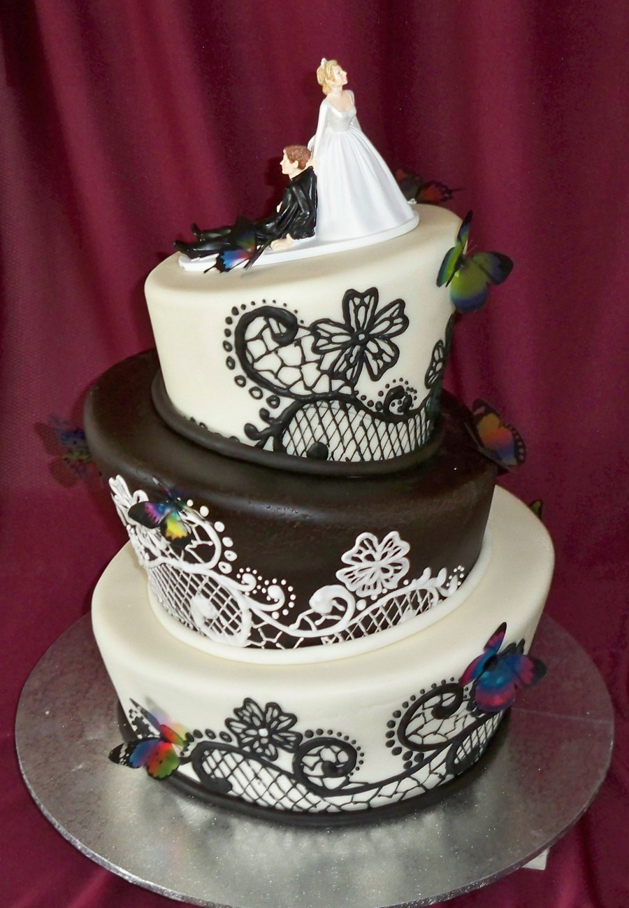 Topsy Turvey Wedding Cakes  Black And White Topsy Turvy Wedding Cake With Butterflies