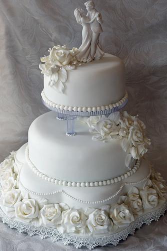 Walmart 3 Tier Wedding Cakes  Classic three tier pillared white rose wedding cake