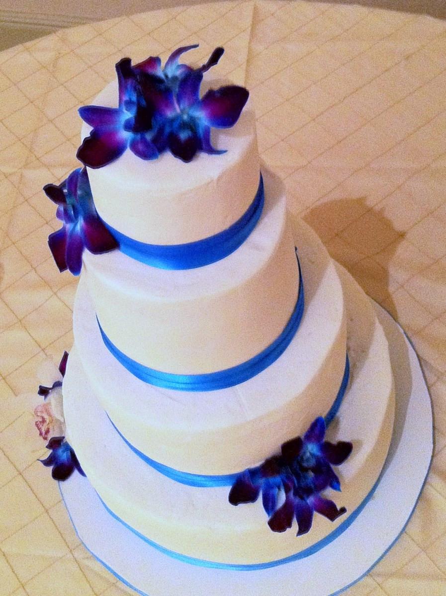 Wedding Cake Blue And White  topaz blue purple orchid and white wedding cake