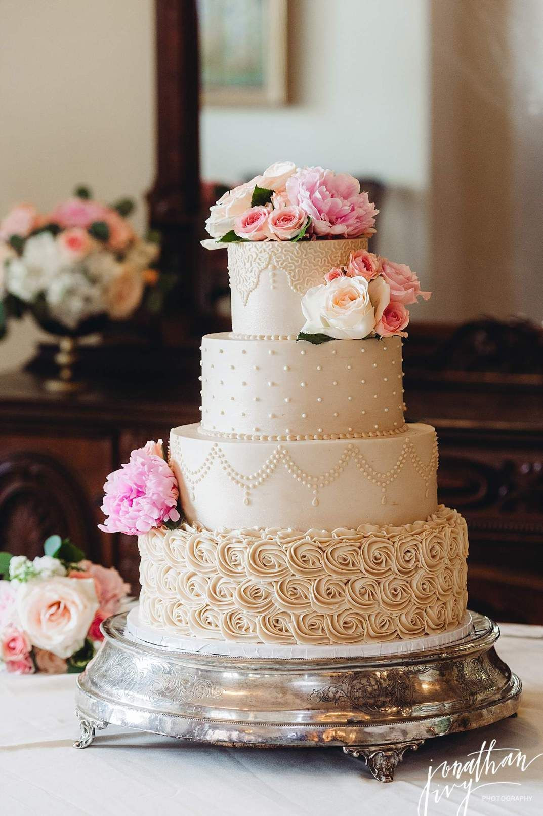 Wedding Cake Recipes For Tiered Cakes  Beautiful beige 4 tier buttercream wedding cake