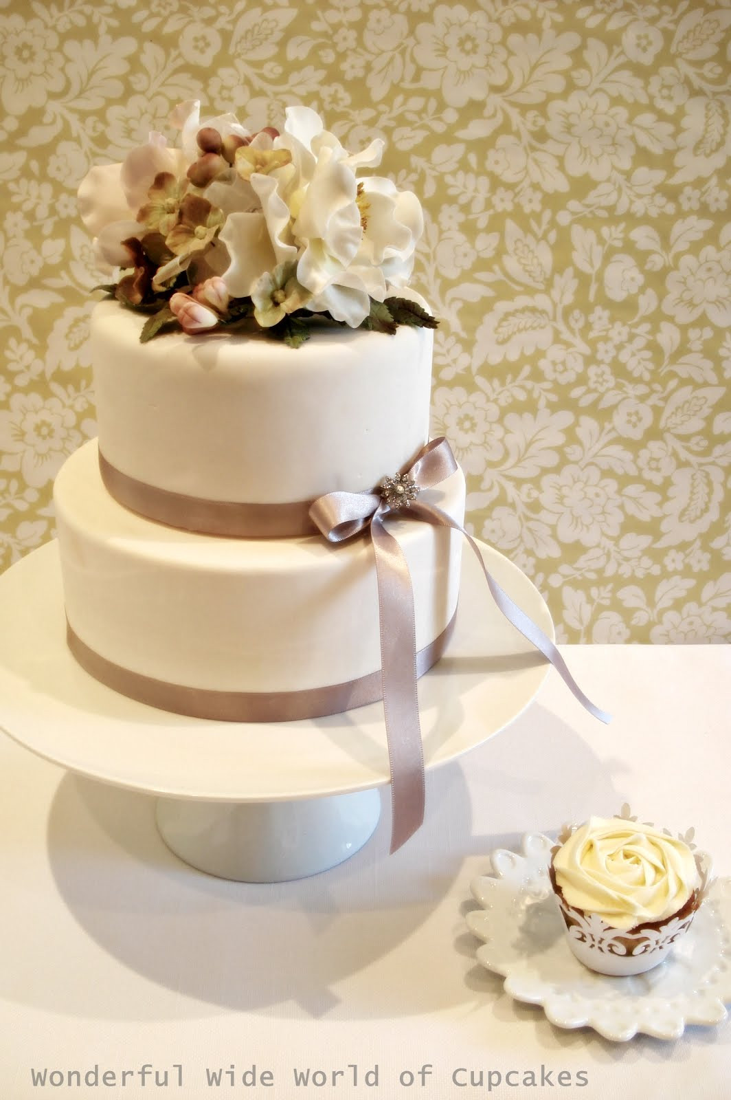 Wedding Cakes 2 Tier  Two tier wedding cake with cupcakes idea in 2017