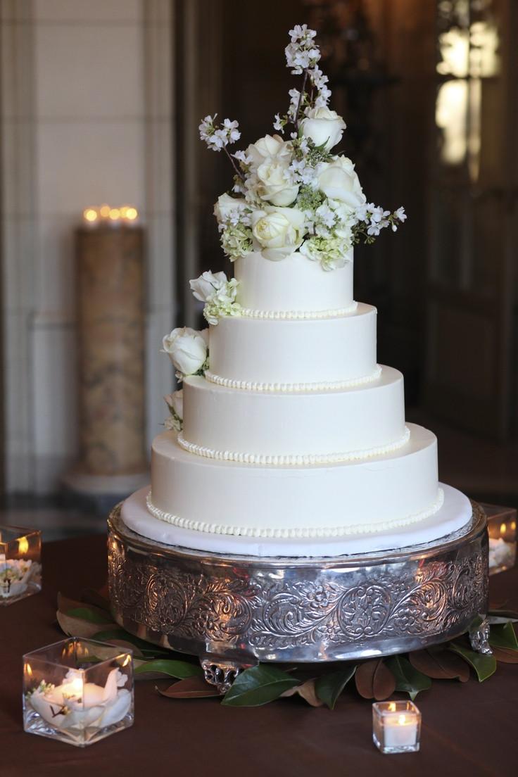 Wedding Cakes 4 Tier  white roses on buttercream 4 tier wedding cake w