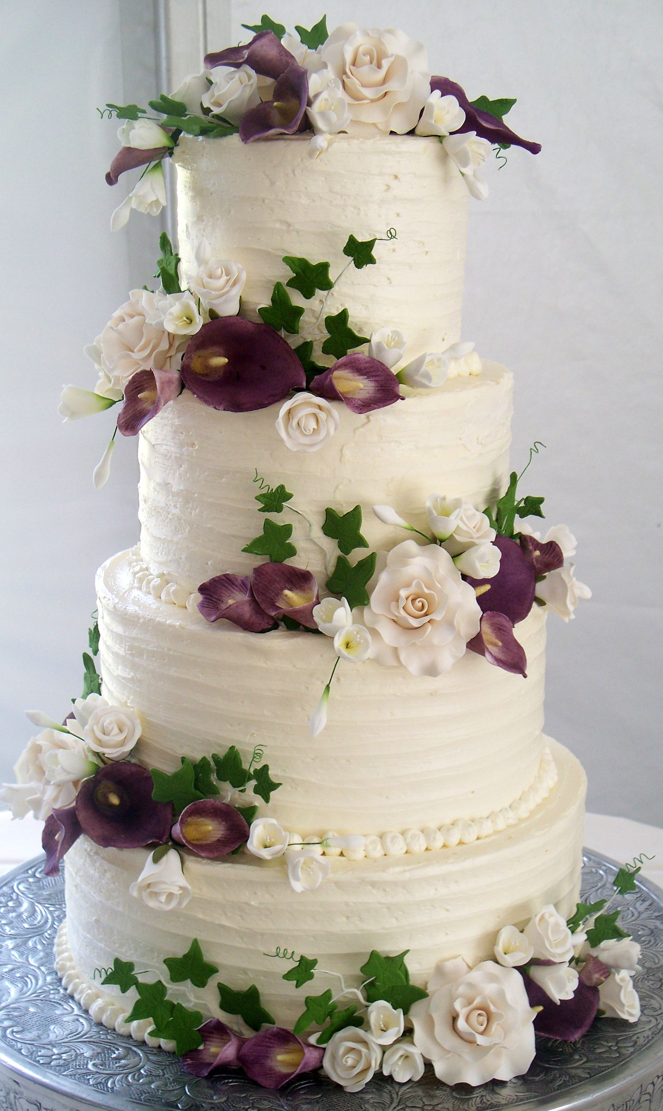 Wedding Cakes 4 Tier  4 tier wedding cake textured buttercream and coordinating