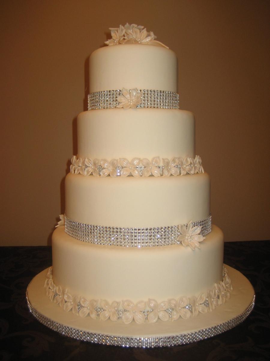 Wedding Cakes 4 Tier  4 Tier Wedding Cake With Flowers And Diamond Wrap