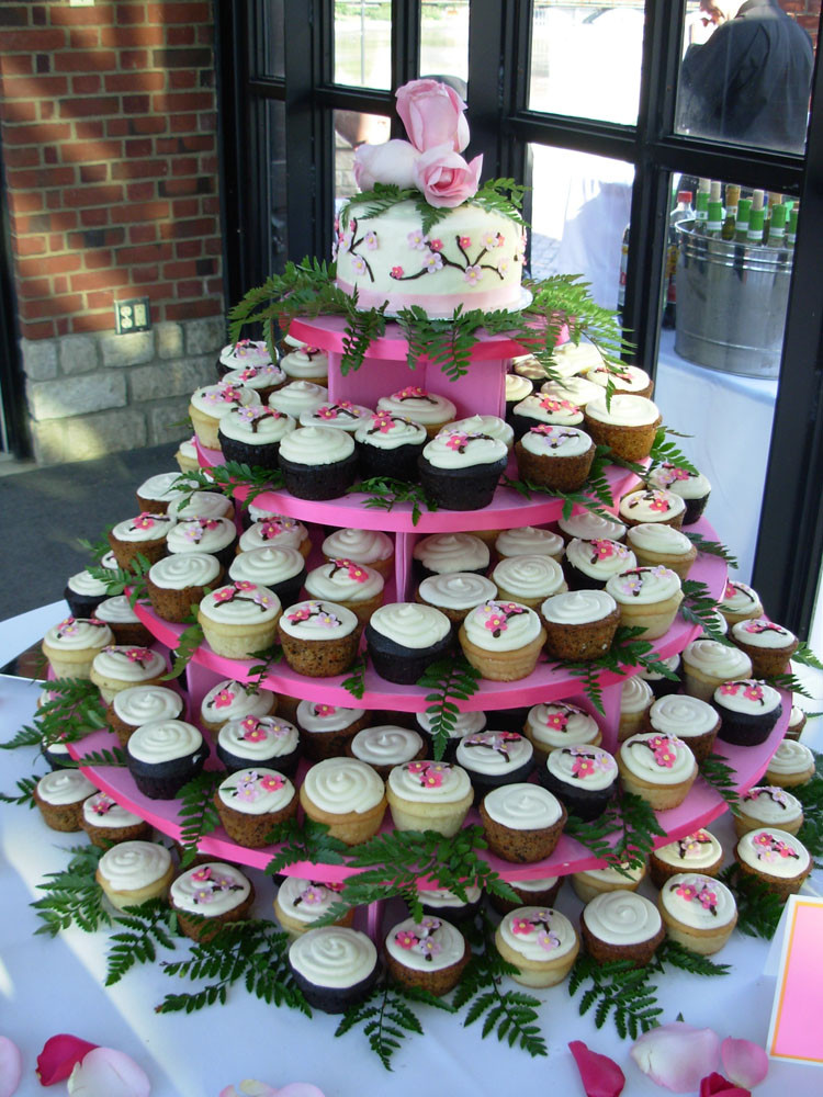 Wedding Cakes And Cup Cakes  Wedding cupcakes at the dinner tables