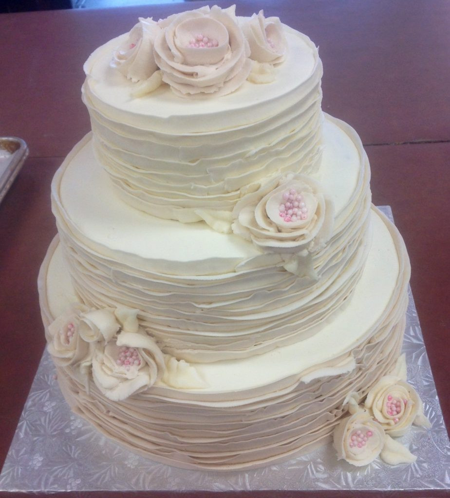 Wedding Cakes Buttercream Frosting  Tiered Streamlined Wedding Cake with Fresh Flowers and