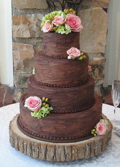 Wedding Cakes Chocolate  Four tier round chocolate wedding cake with pink roses JPG