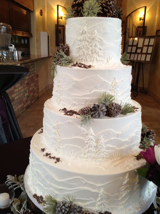 Wedding Cakes Colorado  White frosted cake with mountains and pine trees perfect